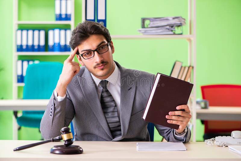 The young handsome lawyer working in the office. Young handsome lawyer working in the office stock photos