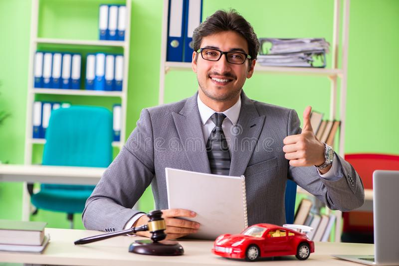 The young handsome lawyer working in the office. Young handsome lawyer working in the office royalty free stock photography
