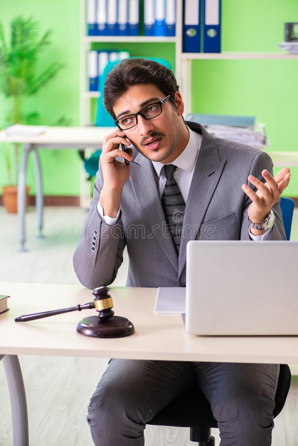 The young handsome lawyer working in the office. Young handsome lawyer working in the office stock images