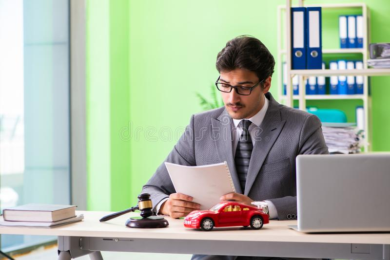 The young handsome lawyer working in the office. Young handsome lawyer working in the office royalty free stock image