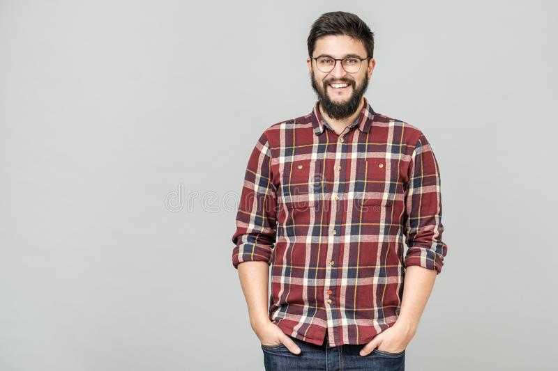 Young handsome male with beard against gray background stock images