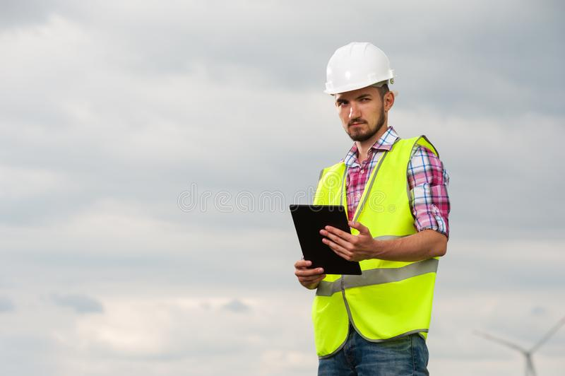 Seious young male engineer in white helmet stock photos