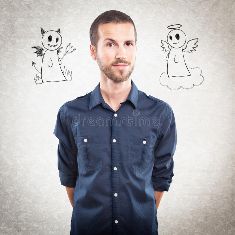 Young handsome man with angel and devil royalty free stock image