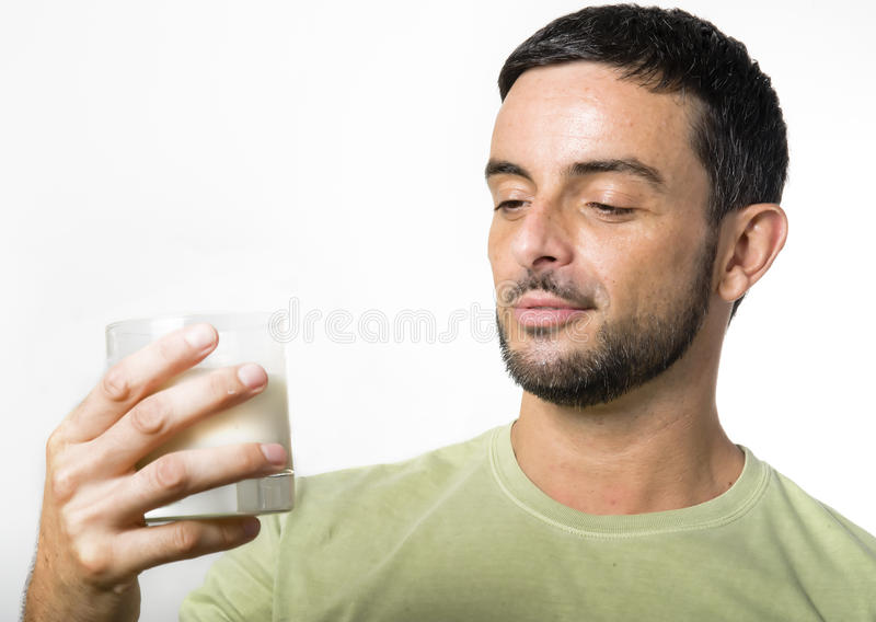 Download Young Handsome Man With Beard Drinking Milk Stock Image - Image: 33150951