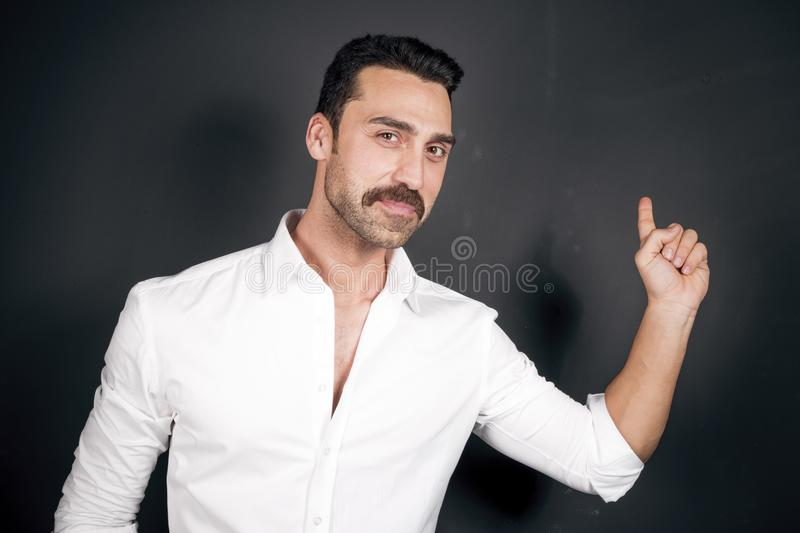 Young handsome man with beard and mustache studio portrait stock image