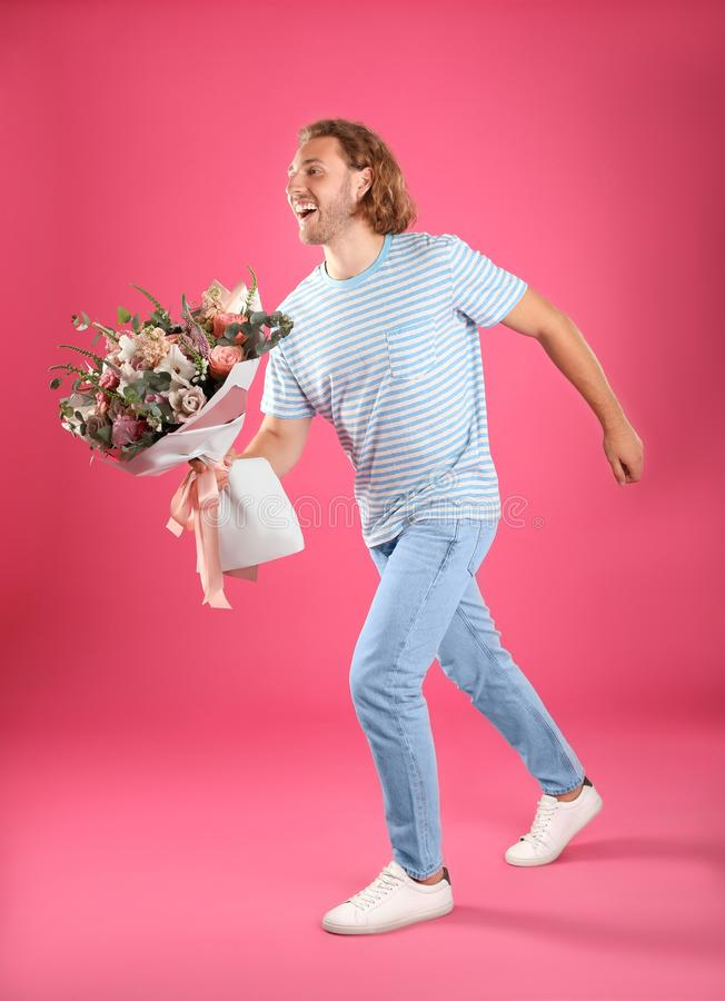 Young handsome man with beautiful flower bouquet royalty free stock photos