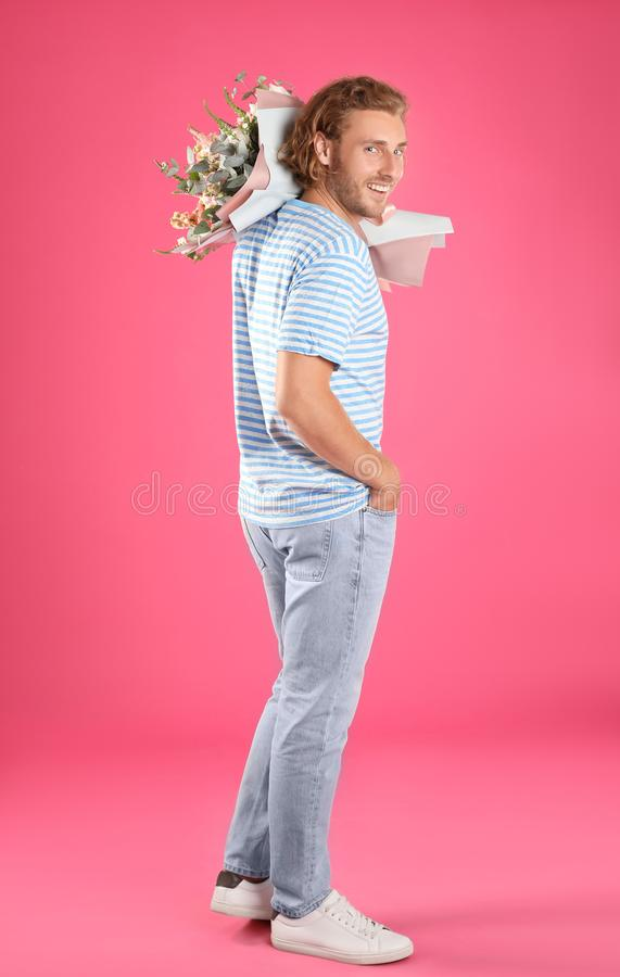 Young handsome man with beautiful flower bouquet royalty free stock images