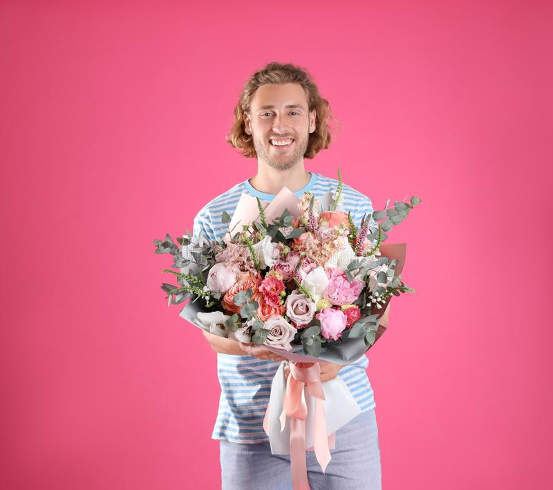 Young handsome man with beautiful flower bouquet stock images