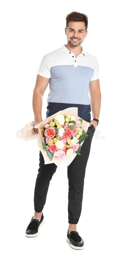 Young handsome man with beautiful flower bouquet on white royalty free stock photo
