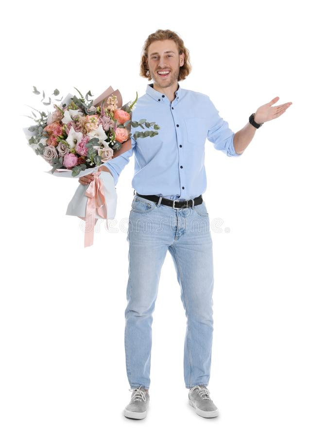 Young handsome man with beautiful flower bouquet royalty free stock photography