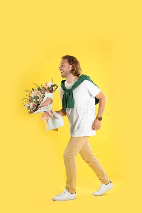 Young handsome man with beautiful flower bouquet stock photos