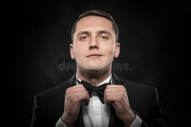 Young handsome man in black suit. stock photography