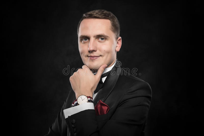 Young handsome man in black suit. stock photos