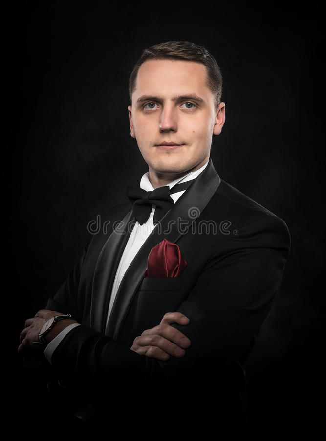Young handsome man in black suit. stock image