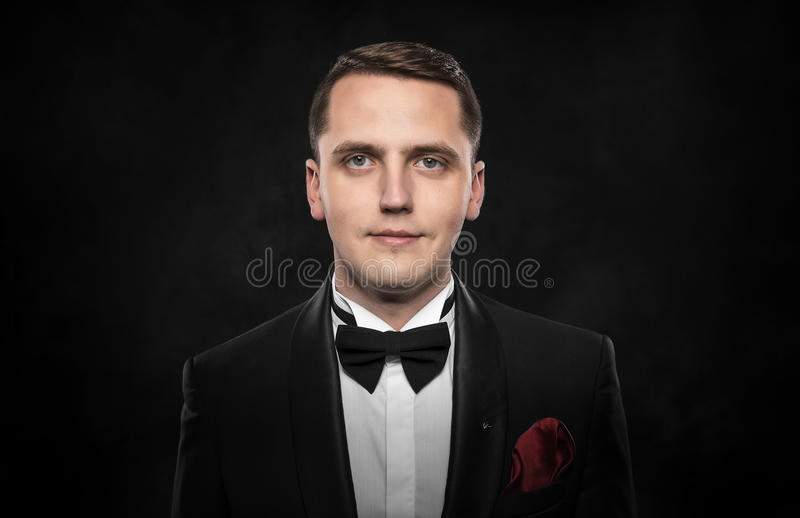 Young handsome man in black suit. stock images