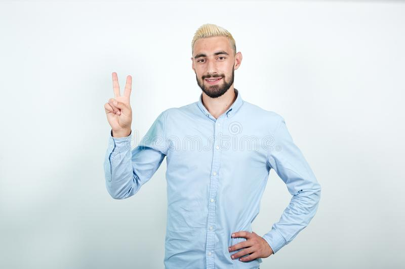 Man with blond hair, black beard over isolated white background shows emotions royalty free stock photography