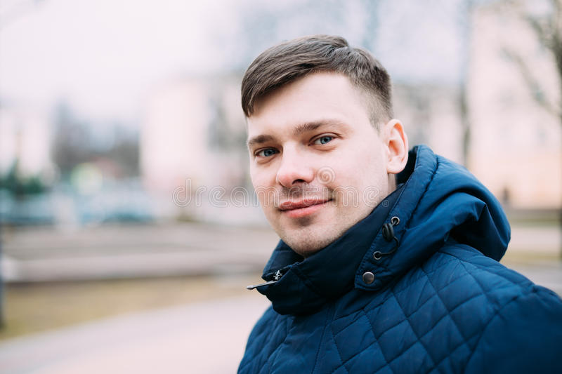 Young Handsome Man In Blue Jacket Outdoor. Spring Season. stock images