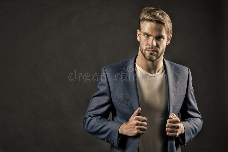 Young handsome man in blue suit royalty free stock photography