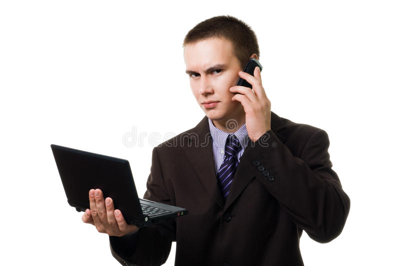 Young Handsome Man With Cell Phone And Laptop Royalty Free Stock Photography