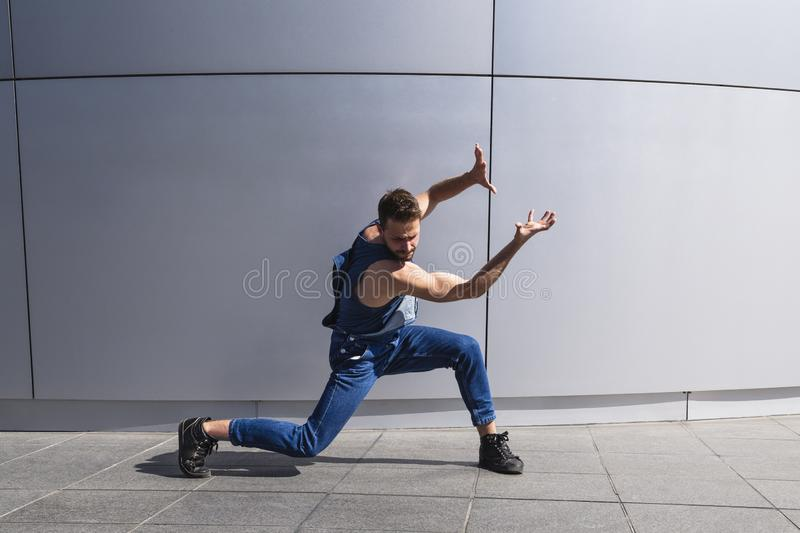 Young handsome man dancer shows contemporary dance royalty free stock photos