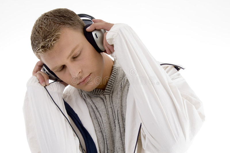 Young handsome man enjoying music with headphones
