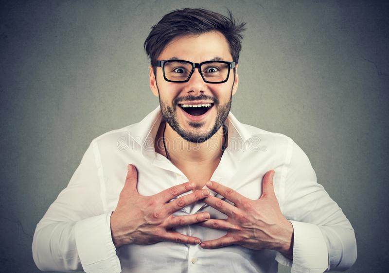 Super excited man looking amazed at camera royalty free stock image