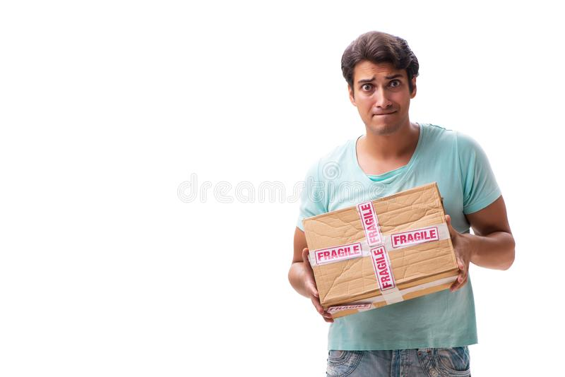 The young handsome man with fragile box ordered from internet. Young handsome man with fragile box ordered from Internet stock image