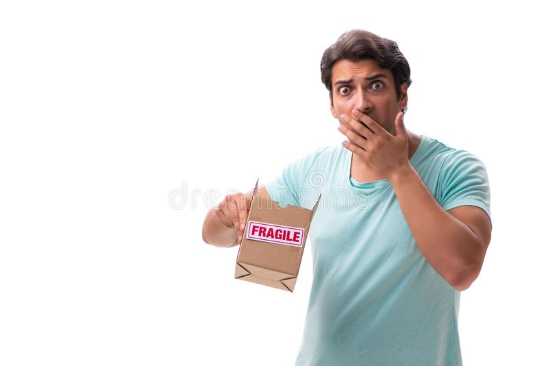 The young handsome man with fragile box ordered from internet. Young handsome man with fragile box ordered from Internet stock photo
