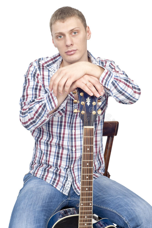 Young handsome man with guitar royalty free stock photos