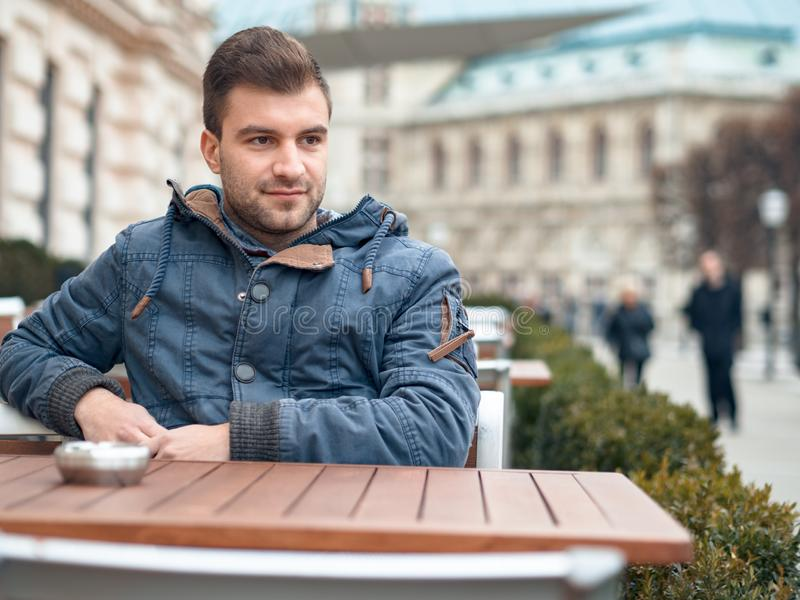Young handsome man lookig. Gorgeous guy looking to side, outdoors. Copyspace for text stock images