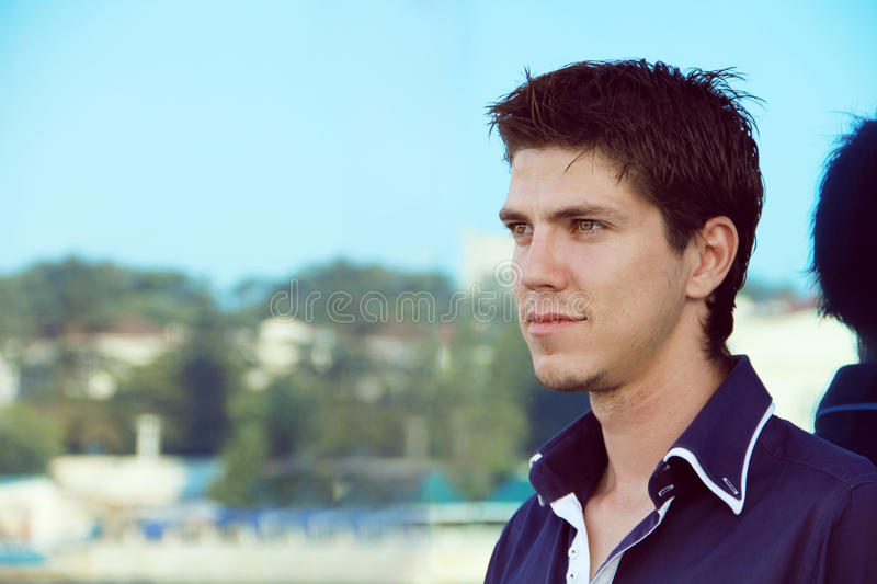 Young handsome man looking away, outdoors royalty free stock photo