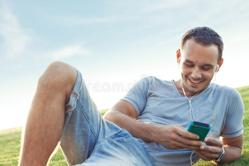 Young and handsome man with mobile smartphone stock image