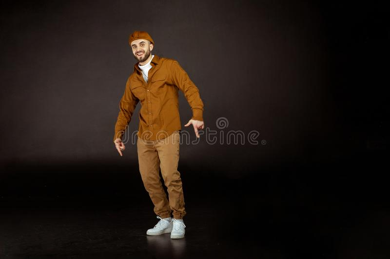 Young handsome man possing and modeling wearing beige clothes royalty free stock photos