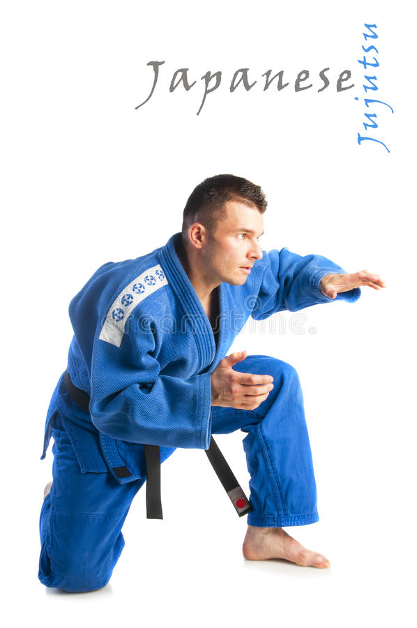 Young handsome man practicing jiu-jitsu. (Hakki Heysen Ryu school) isolated on white background royalty free stock images