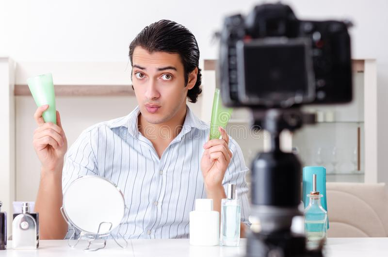 Young handsome man recording his blog in hygiene concept royalty free stock image