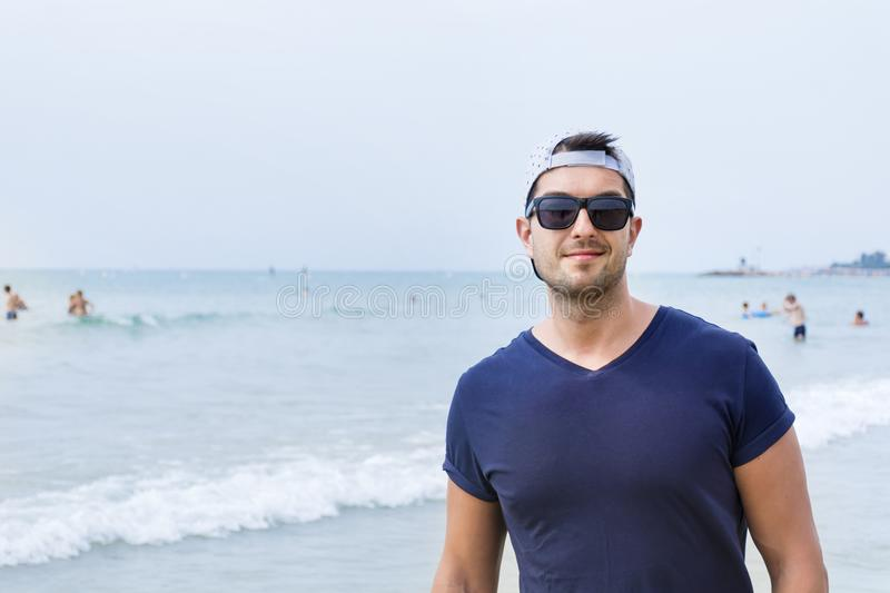 Young Handsome Man on a Sea Background stock images