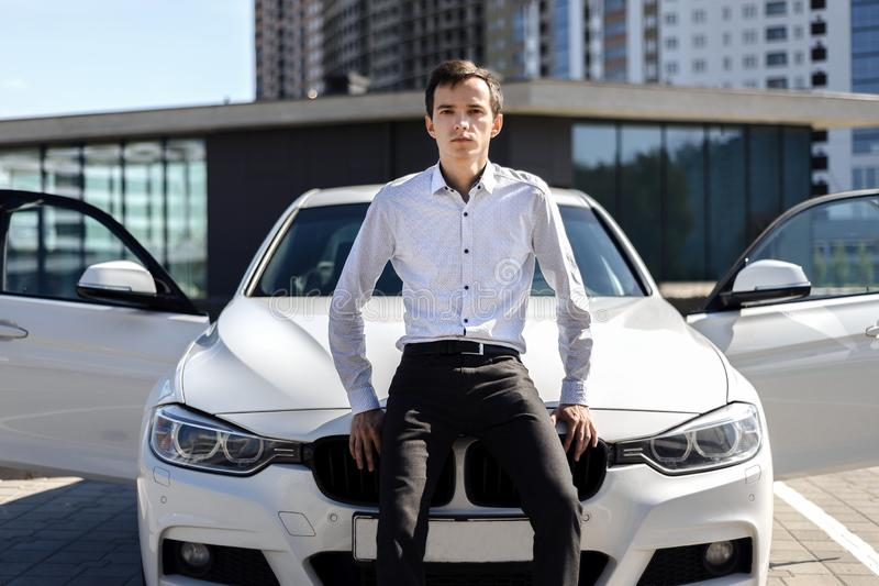 Young handsome man in shirt near the car royalty free stock image