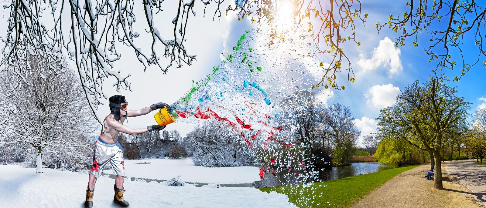 Spring splash!. A young handsome man in shorts throws spring into the world and ends winter with a colorful splash stock photos