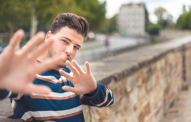 Young handsome man showing her palms - hands, selective focus royalty free stock image