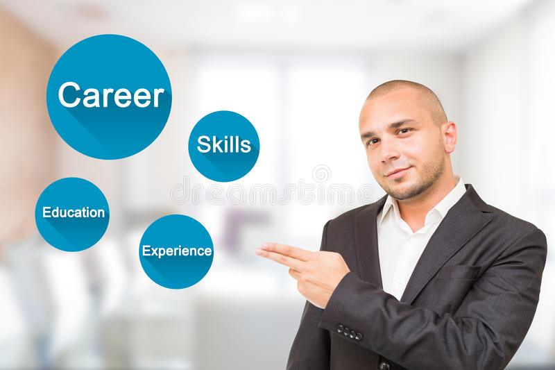 Young handsome man shows important attributes in career stock photos