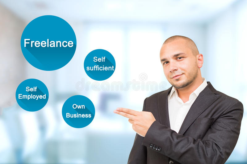 Young handsome man shows important attributes in Freelance work. stock image