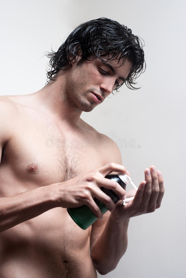 Young Handsome Man With A Skin For Shaving Royalty Free Stock Photos