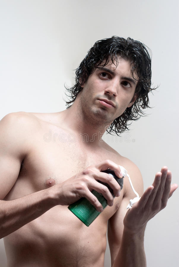 Young handsome man with a skin for shaving stock photography
