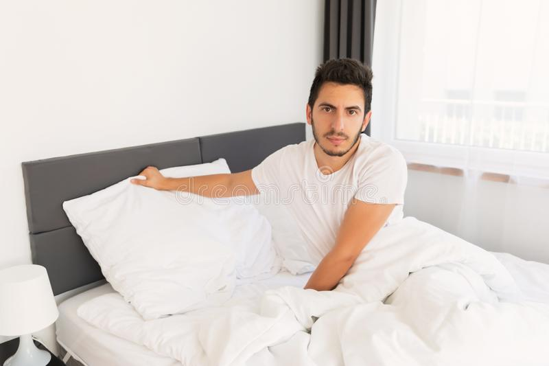 Young handsome man sleeping in his bed. royalty free stock image