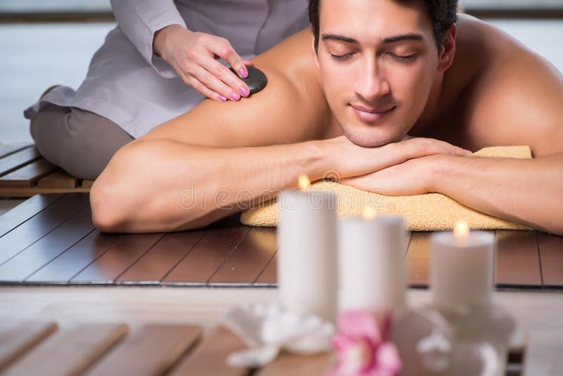 The young handsome man during spa procedure royalty free stock image
