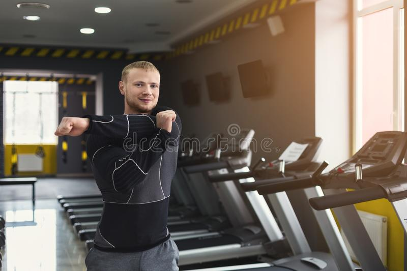 Young man warming up before training in gym stock photos