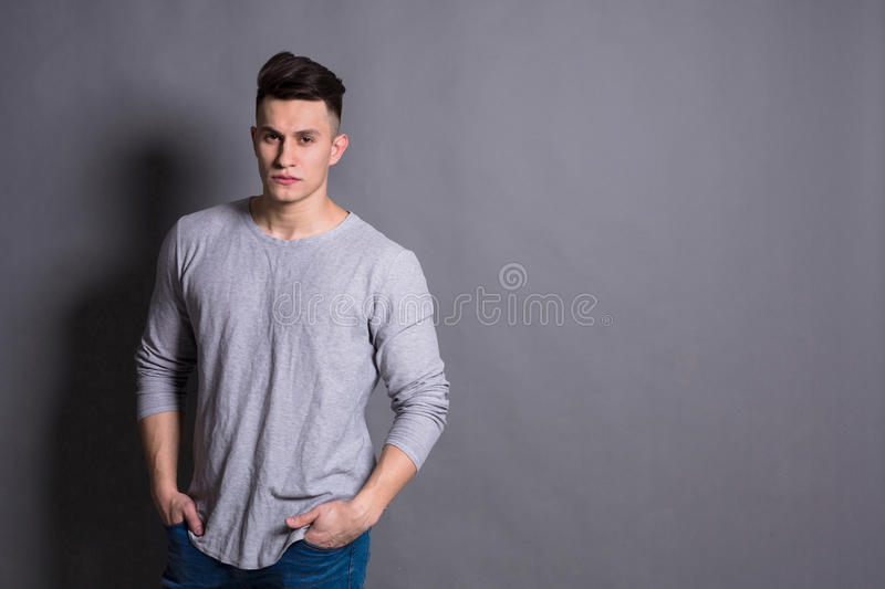Young handsome man studio portrait, boy style stock images