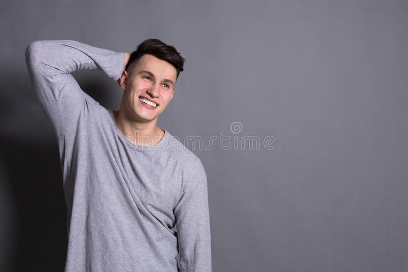 Young handsome man studio portrait, boy style. Young handsome man studio portrait. Boy style, trendy hipster in casual look with cool hairstyle, copy space royalty free stock photography