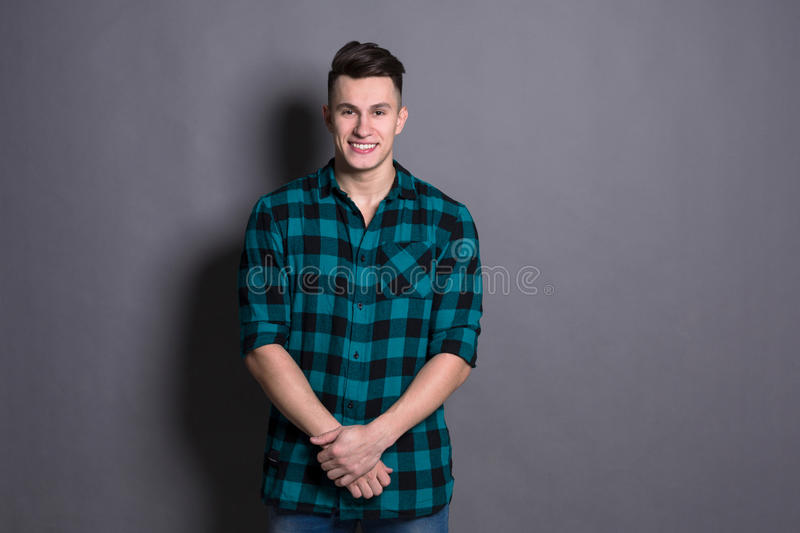 Young handsome man studio portrait, boy style stock image
