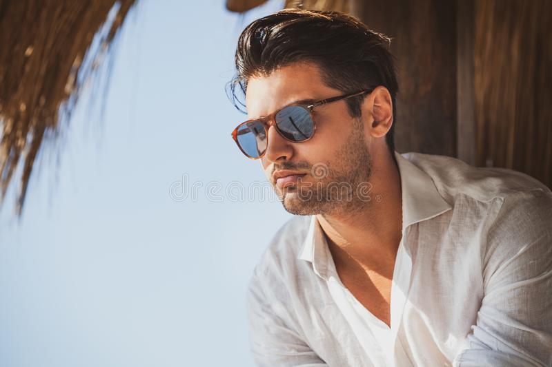 Young and handsome man with sunglasses looking. stock image